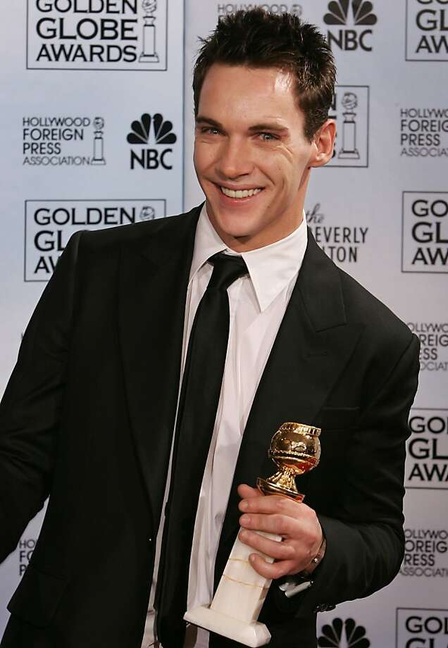"Irish actor Jonathan Rhys-Meyers poses with the award he won for best actor in a mini-series or television movie for his work on ""Elvis,"" at the 63rd Annual Golden Globe Awards on Monday, Jan. 16, 2006, in Beverly Hills, Calif.  (AP Photo/Reed Saxon) Photo: Reed Saxon, AP"