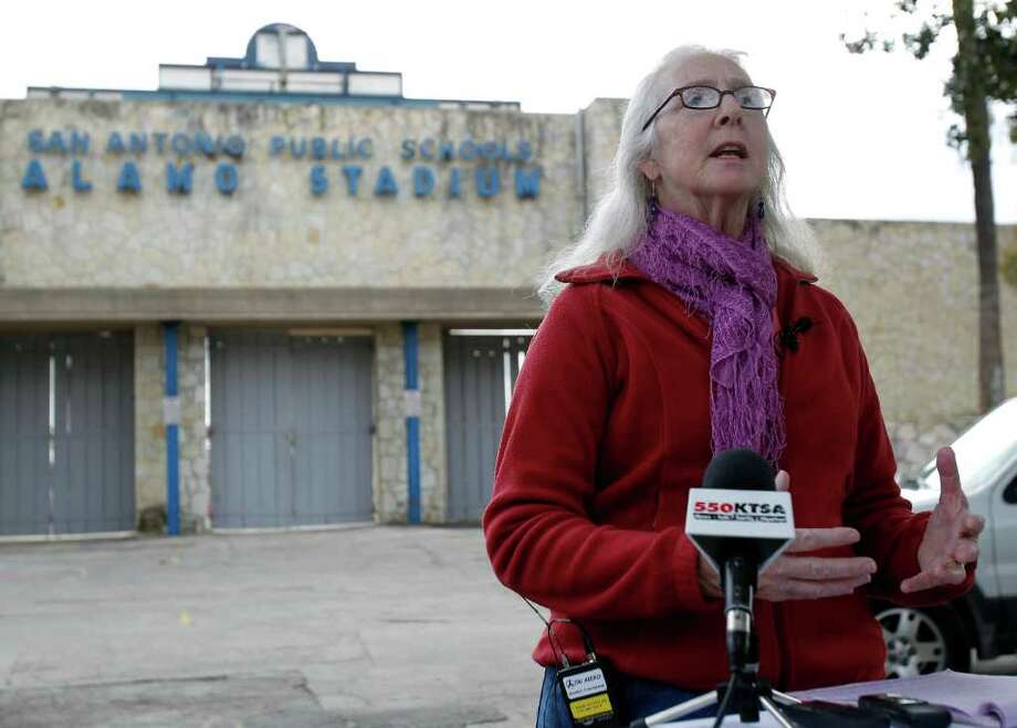 Patti Radle, member of the Board of Trustees in the San Antonio Independent School District, speaks during a press conference against the possible removal of the track at Alamo Stadium on Friday, Dec. 9, 2011. Photo: MICHAEL MILLER, SAN ANTONIO EXPRESS-NEWS / mmiller@express-news.net