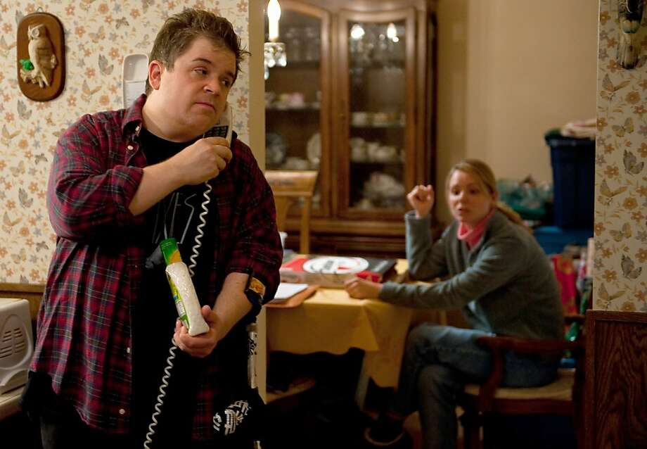 "In this image released by Paramount Pictures, Patton Oswalt portrays Matt Freehauf, left, and Collette Wolfe portrays Sandra Freehaufin a scene from ""Young Adult."" (AP Photo/Paramount Pictures, Phillip V. Caruso) Photo: Phillip V. Caruso, AP"