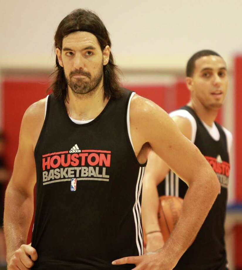 Houston Rockets forward Luis Scola waits his turn to shoot free throws as Kevin Martin walks by during training camp, Friday, Dec. 9, 2011, in the Rockets training facility  Toyota Center  in Houston. Luis Scola and Kevin Martin are players invloved in a three team trade. Photo: Nick De La Torre, Houston Chronicle / © 2011  Houston Chronicle