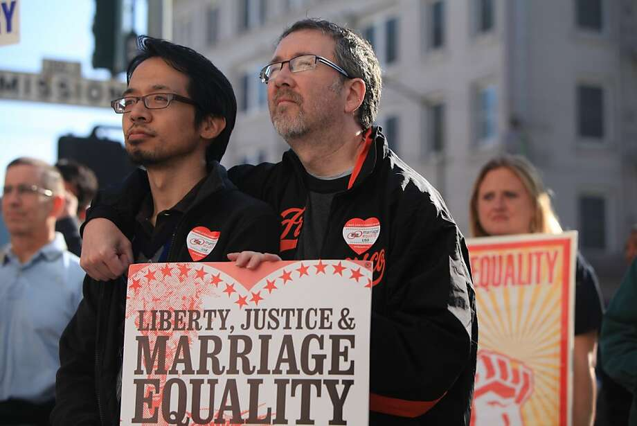 "Jeff Tabaco and Thom Watson, both of Daly City, listen to speakers during a ""Free the Tapes"" and ""Motion to Marry"" rally preceding the circuit court hearing on Proposition 8 in front of the Ninth U.S. Circuit Court of Appeals on Thursday, December 8, 2011 in San Francisco, Calif. Photo: Lea Suzuki, The Chronicle"