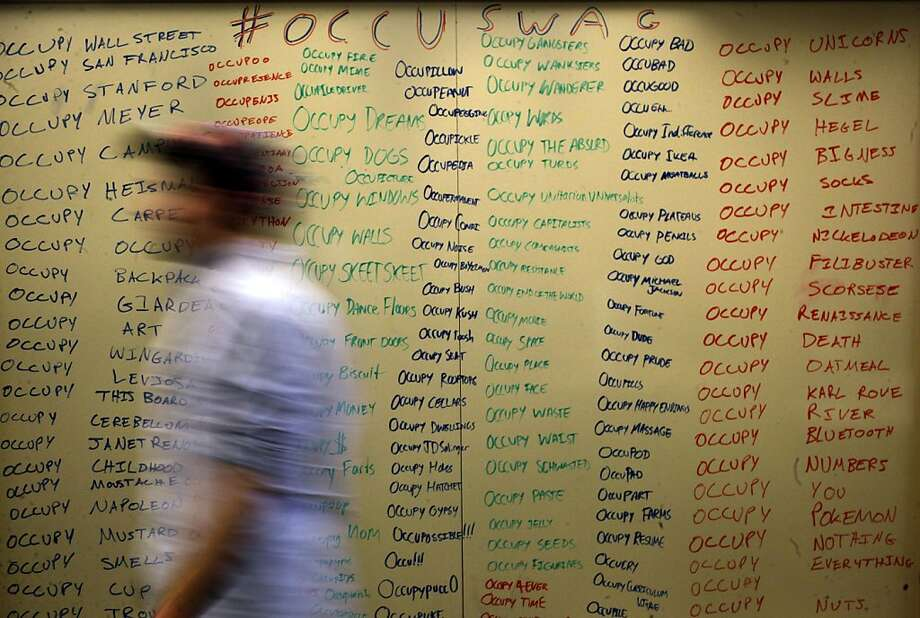 "The back-side of their white board displays an Occu-poem, at the home of Occupy Stanford inside the Henry J. Meyer Memorial Library, on campus in Palo Alto, Ca., on Wednesday December 7, 2011. The Occupy Wall Street movement pierces the self-described ""Stanford bubble"" friday--but Occupy looks different on a campus where an estimated 16 percent of the students come from families who are part of the one percent. Occupy Stanford has different facets of the movement including, Occupy Stanford and Occupy the Future. Photo: Michael Macor, The Chronicle"
