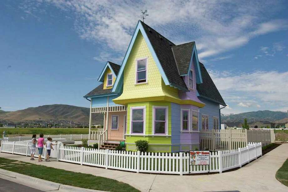 "In this July 6, 2011 photo, a full scale rendition of the house in the animated movie, ""Up,"" located a  in Herriman, Utah, will be part of this year's Parade of Homes.  The house  has been sold to a family who are self-described Disney and Pixar fanatics. Clinton and Lynette Hamblin of Petaluma, Calif., are buying the home in Herriman, Utah, for $400,000.  The Hamblins say they were searching for a home in California that was similar to the colorful cottage seen in the movie when they heard about the Disney-approved ""Up"" house in Utah. Photo: Paul Fraughton, AP / The Salt Lake Tribune"