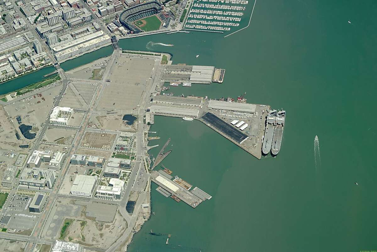 Aerial image of piers 48 and 50 may be the epicenter of the 2013 America's Cup. Mayor Gavin Newsom introduces a binding agreement the city has hammered out with America?•s Cup organizers to host the 2013 regatta in San Francisco. If approved by the Board of Supervisors, the deal provides a concrete commitment by the city to host the cup if Oracle billionaire Larry Ellison agrees to hold it here. That decision is expected by the end of the year, but things look very good for San Francisco if the city approves a deal that the team has been intimately involved in crafting. Ran on: 11-10-2010 Photo caption Dummy text goes here. Dummy text goes here. Dummy text goes here. Dummy text goes here. Dummy text goes here. Dummy text goes here. Dummy text goes here. Dummy text goes here.###Photo: cup10_PH_aerial20###Live Caption:Aerial image of piers 48 and 50 may be the epicenter of the 2013 America's Cup. Mayor Gavin Newsom introduces a binding agreement the city has hammered out with America?s Cup organizers to host the 2013 regatta in San Francisco. If approved by the Board of Supervisors, the deal provides a concrete commitment by the city to host the cup if Oracle billionaire Larry Ellison agrees to hold it here. That decision is expected by the end of the year, but things look very good for San Francisco if the city approves a deal that the team has been intimately involved in crafting.###Caption History:Aerial image of piers 48 and 50 may be the epicenter of the 2013 America's Cup. Mayor Gavin Newsom introduces a binding agreement the city has hammered out with America Ran on: 11-10-2010 Photo caption Dummy text goes here. Dummy text goes here. Dummy text goes here. Dummy...