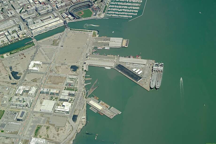 Aerial image of piers 48 and 50 may be the epicenter of the 2013 America's Cup. Mayor Gavin Newsom introduces a binding agreement the city has hammered out with AmericaÕs Cup organizers to host the 2013 regatta in San Francisco. If approved by the Board of Supervisors, the deal provides a concrete commitment by the city to host the cup if Oracle billionaire Larry Ellison agrees to hold it here. That decision is expected by the end of the year, but things look very good for San Francisco if the city approves a deal that the team has been intimately involved in crafting.   Ran on: 11-10-2010 Photo caption Dummy text goes here. Dummy text goes here. Dummy text goes here. Dummy text goes here. Dummy text goes here. Dummy text goes here. Dummy text goes here. Dummy text goes here.###Photo: cup10_PH_aerial20###Live Caption:Aerial image of piers 48 and 50 may be the epicenter of the 2013 America's Cup. Mayor Gavin Newsom introduces a binding agreement the city has hammered out with America?s Cup organizers to host the 2013 regatta in San Francisco. If approved by the Board of Supervisors, the deal provides a concrete commitment by the city to host the cup if Oracle billionaire Larry Ellison agrees to hold it here. That decision is expected by the end of the year, but things look very good for San Francisco if the city approves a deal that the team has been intimately involved in crafting.###Caption History:Aerial image of piers 48 and 50 may be the epicenter of the 2013 America's Cup. Mayor Gavin Newsom introduces a binding agreement the city has hammered out with America Ran on: 11-10-2010 Photo caption Dummy text goes here. Dummy text goes here. Dummy text goes here. Dummy text goes here. Dummy text goes here. Dummy text goes here. Dummy text goes here. Dummy text goes here.###Photo: cup10_PH_aerial20###Live Caption:Aerial image of piers 48 Photo: Pictometry International