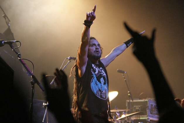 Mark Osegueda of Death Angel points skyward during a performance at the Warfield Theater in San Francisco, Calif., on Sunday, Oct. 23, 2011. Photo: Dylan Entelis, The Chronicle