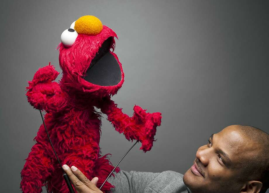 """Kevin Clash, 51, is the genius behind the lovable """"Sesame Street"""" character Elmo. The story of how Clash went from being a 10-year-old making his own puppets to creating one of the most recognizable Muppets ever is told in a new movie, """"Being Elmo: A Puppeteer's Journey."""" Illustrates KIDSPOST-ELMO (category l), by Tracy Grant (c) 2011, The Washington Post. Moved Wednesday, Nov. 16, 2011. (MUST CREDIT: Scott McDermott) Photo: Handout, The Washington Post"""