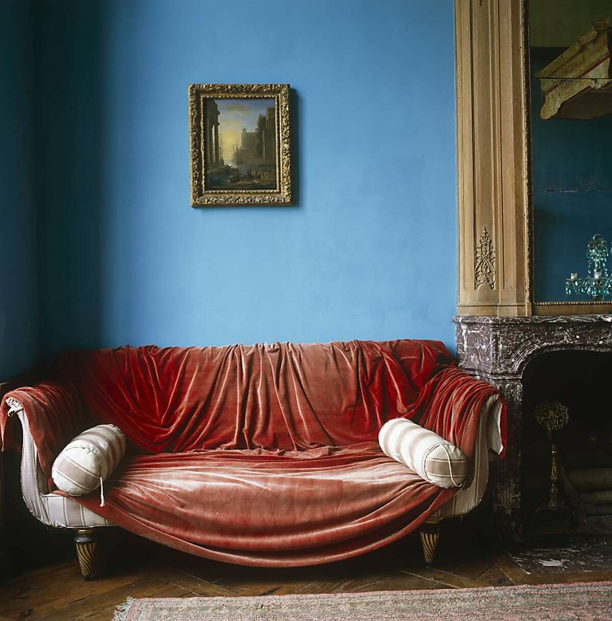 Excerpted from The Right Color by Eve Ashcraft (Artisan Books). A red velvet curtain is tossed casually over a Regency sofa in a room painted a powder blue