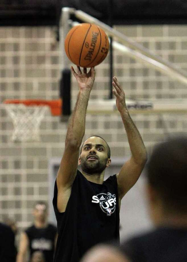 Tony Parker takes a shot during practice as players for the San Antonio Spurs attend their first team practice on Friday, Dec. 9, 2011.  Kin Man Hui/kmhui@express-news.net Photo: KIN MAN HUI, Express-News / SAN ANTONIO EXPRESS-NEWS