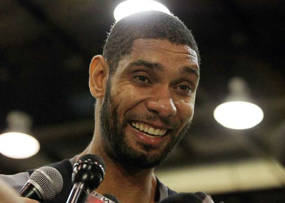 Spurs forward Tim Duncan smiles as he chats with the media as players for the San Antonio Spurs attend their first team practice on Friday, Dec. 9, 2011.  Kin Man Hui/kmhui@express-news.net Photo: KIN MAN HUI, Express-News / SAN ANTONIO EXPRESS-NEWS