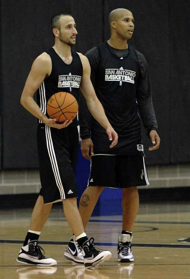 Manu Ginobili (left) and Richard Jefferson are seen at practice as players for the San Antonio Spurs attend their first team practice on Friday, Dec. 9, 2011.  Kin Man Hui/kmhui@express-news.net Photo: KIN MAN HUI, Express-News / SAN ANTONIO EXPRESS-NEWS