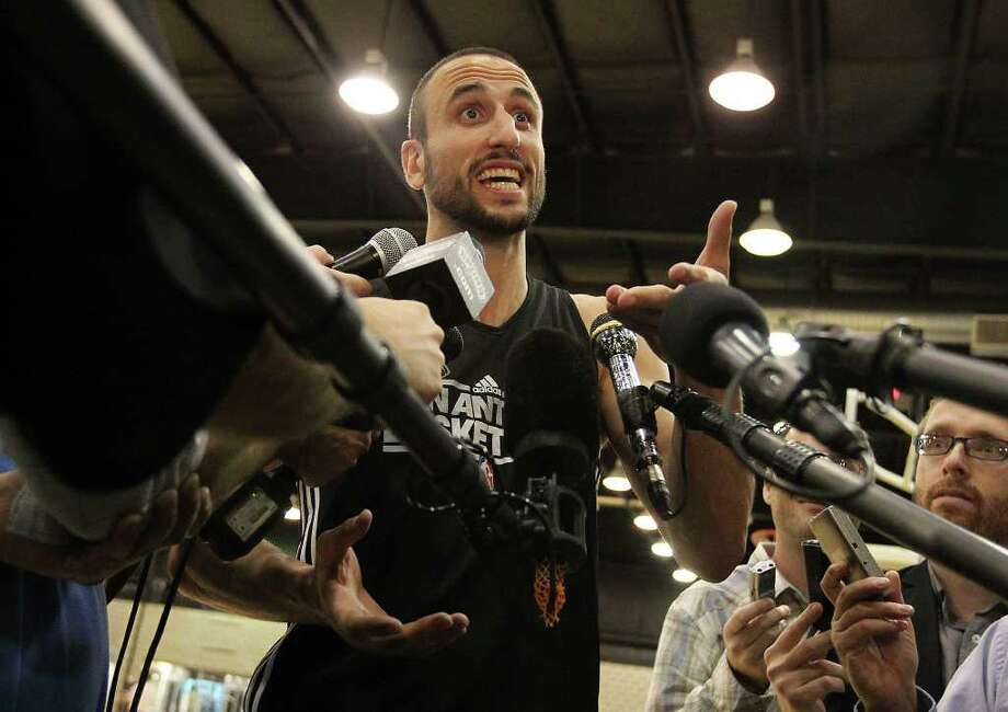 Manu Ginobili answers questions by media as players for the San Antonio Spurs attend their first team practice on Friday, Dec. 9, 2011.  Kin Man Hui/kmhui@express-news.net Photo: KIN MAN HUI, Express-News / SAN ANTONIO EXPRESS-NEWS