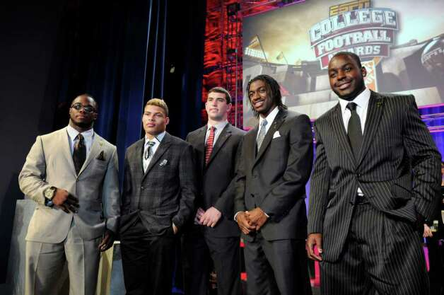 Heisman Trophy finalists, from left, Alabama's Trent Richardson, LSU's Tyrann Mathieu, Stanford's Andrew Luck, Baylor's Robert Griffin III, and Wisconsin's Montee Ball pose after the College Football Awards show in Lake Buena Vista, Fla., Thursday, Dec. 8, 2011. The Heisman Trophy will be awarded to one of the five, Saturday, Dec. 10, in New York. Photo: AP