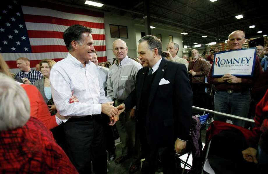 Republican presidential candidate, former Massachusetts Gov. Mitt Romney greets supporters before speaking at a town hall meeting, Friday, Dec. 9, 2011, in Cedar Rapids, Iowa. (AP Photo/Charlie Neibergall) Photo: Charlie Neibergall