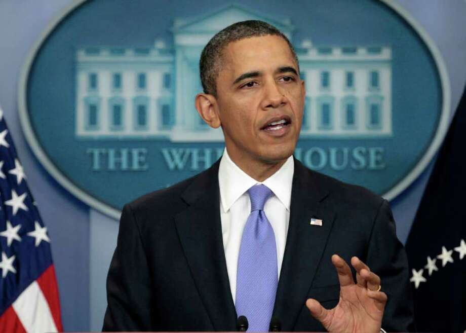 President Barack Obama gestures during a news conference, Thursday, Dec. 8, 2011, in the White House briefing room in Washington. (AP Photo/Carolyn Kaster) Photo: Carolyn Kaster