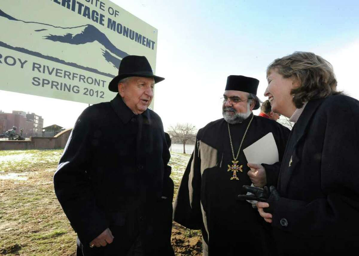 From left, Rev. Vincent Kumjian and Rev. Bedros Shetilian talk to Rensselaer County Executive Kathleen Jimino after a service for the future American Heritage Monument in Troy Riverfont Park on Friday, Dec. 9, 2011 in Troy, N.Y. (Lori Van Buren / Times Union)