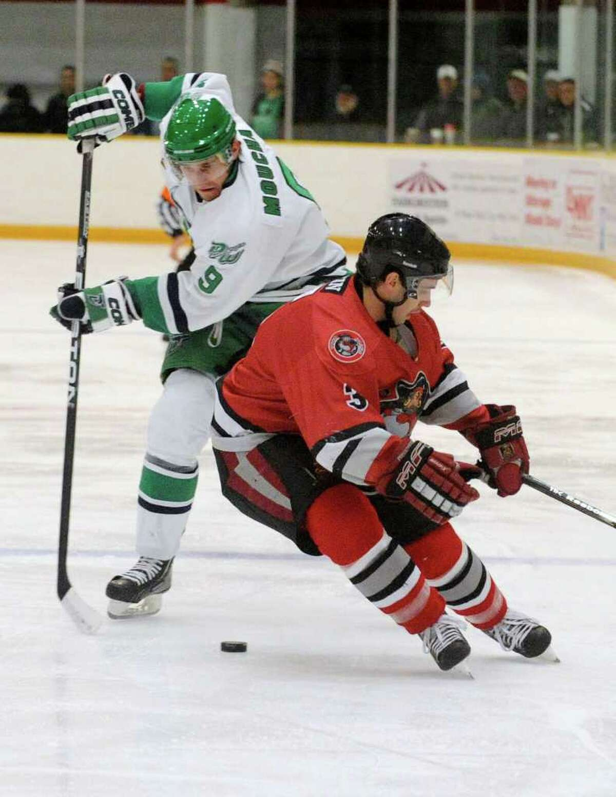 The Danbury Whalers' Martin Moucha tries to get the puck past Thousand Islands' Chad Bazin during their game at Danbury Ice Arena on Friday, Dec. 9, 2011.