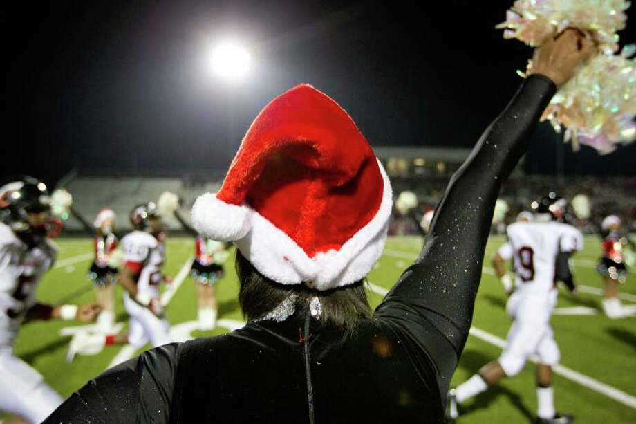 Members of the Coldspring drill team are decked out for the holidays as their team takes the field to face Wimberley. Photo: Smiley N. Pool, Houston Chronicle / © 2011  Houston Chronicle