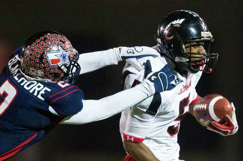 Dec. 9: Wimberley 21, Coldspring-Oakhurst 14Coldspring quarterback Alfred Scott (5) is dragged down by Wimberley defensive back Brennen Blackemore. Wimberley advanced to the Class 3A Division II final with the victory. Photo: Smiley N. Pool, Houston Chronicle / © 2011  Houston Chronicle