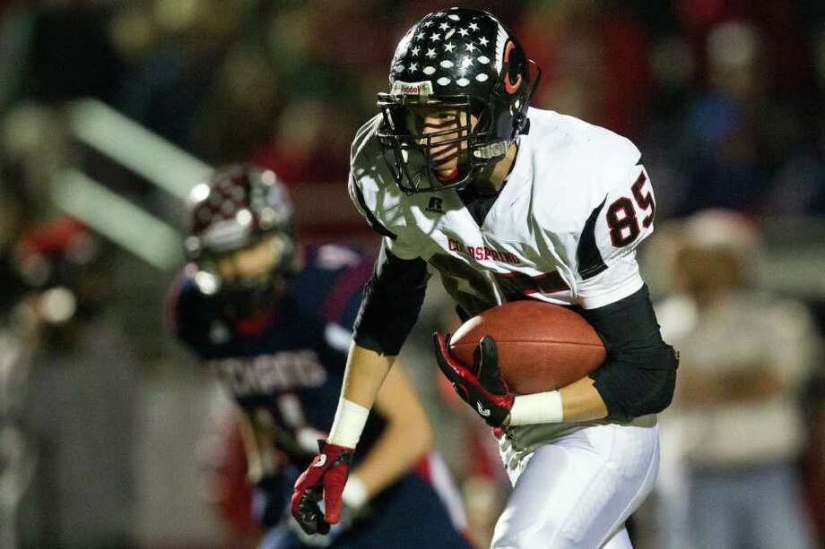 Coldspring tight end Casey Lilley takes off after catching a pass. Photo: Smiley N. Pool, Houston Chronicle / © 2011  Houston Chronicle