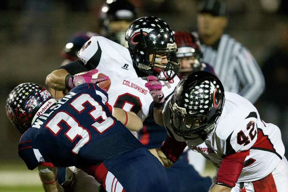 Coldspring running back Colton Monroe (8) is brought down by Wimberley linebacker Trinity Wilson. Photo: Smiley N. Pool, Houston Chronicle / © 2011  Houston Chronicle