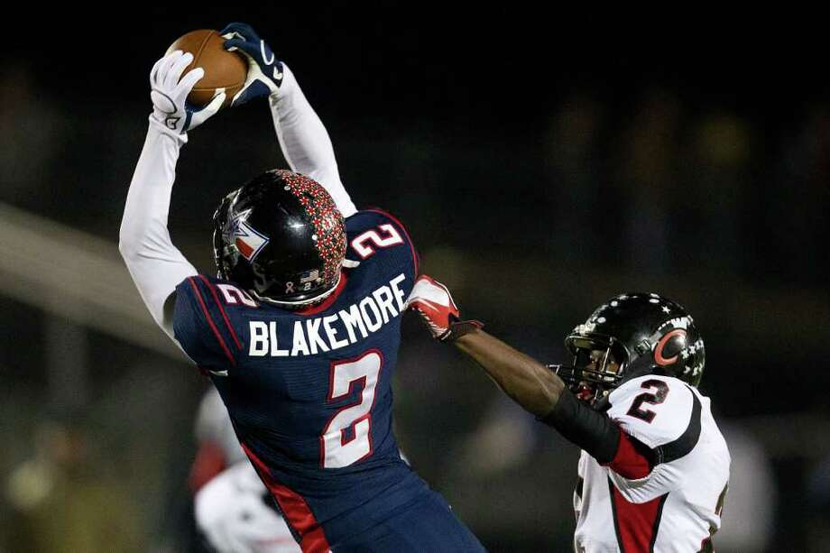 Wimberley wide receiver Brennen Blackemore (2) catches a long pass to set up a touchdown on the opening drive as Coldspring defensive back Douglas Johnson defends. Photo: Smiley N. Pool, Houston Chronicle / © 2011  Houston Chronicle