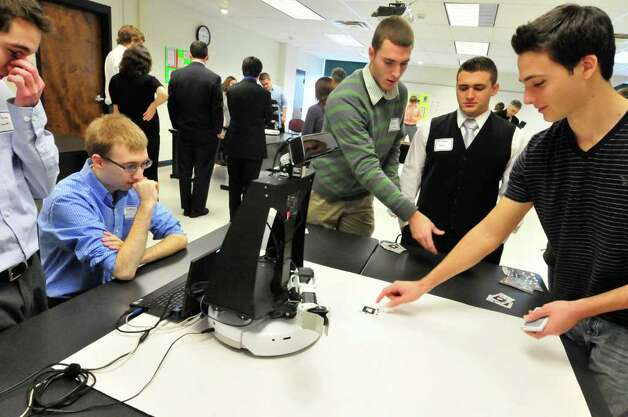 Siena student Paul Amodeo,right, trys his luck against a computer named , Vanessa, a computer programed to play and identify cards during the Siena College RoboShow at the college in Loudonville, NY Friday, Dec.9, 2011.The RoboShow showcased the hard work of students who have spent the semester building robots.( Michael P. Farrell/Times Union) Photo: Michael P. Farrell