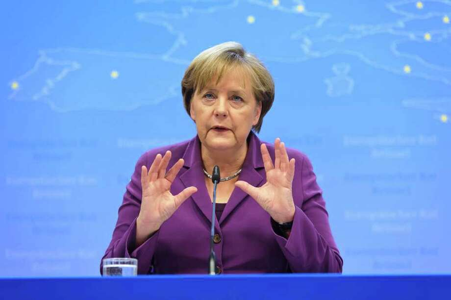 Angela Merkel, Germany's chancellor, gestures during a news conference following a summit of European Leaders at the European Council headquarters in Brussels, Belgium, on Friday, Dec. 9, 2011. European leaders added 200 billion euros ($267 billion) to their crisis-fighting war-chest and tightened anti-deficit rules, seeking to lure the European Central Bank into stepping up its rescue operations. Photographer: Jock Fistick/Bloomberg *** Local Caption *** Angela Merkel Photo: Jock Fistick, Bloomberg / © 2011 Bloomberg Finance LP