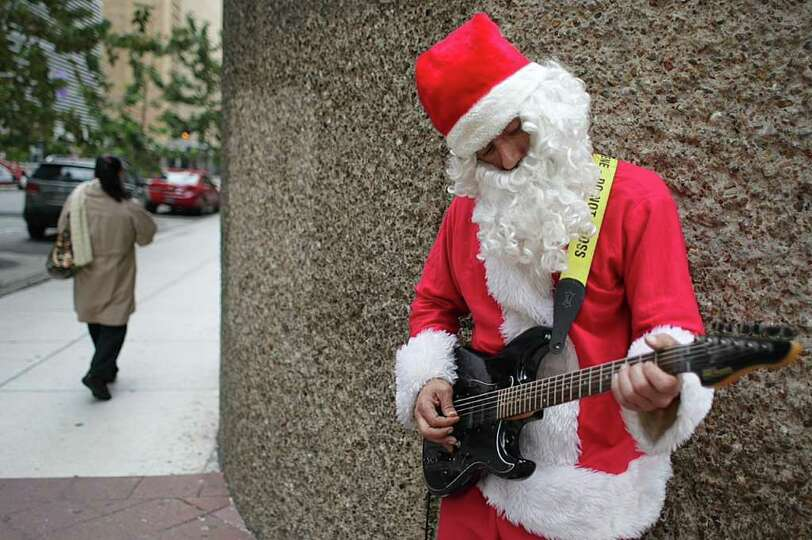 David Diaz, of Houston, says he plays to cultivate infectious joy while on the corner of Milam and D