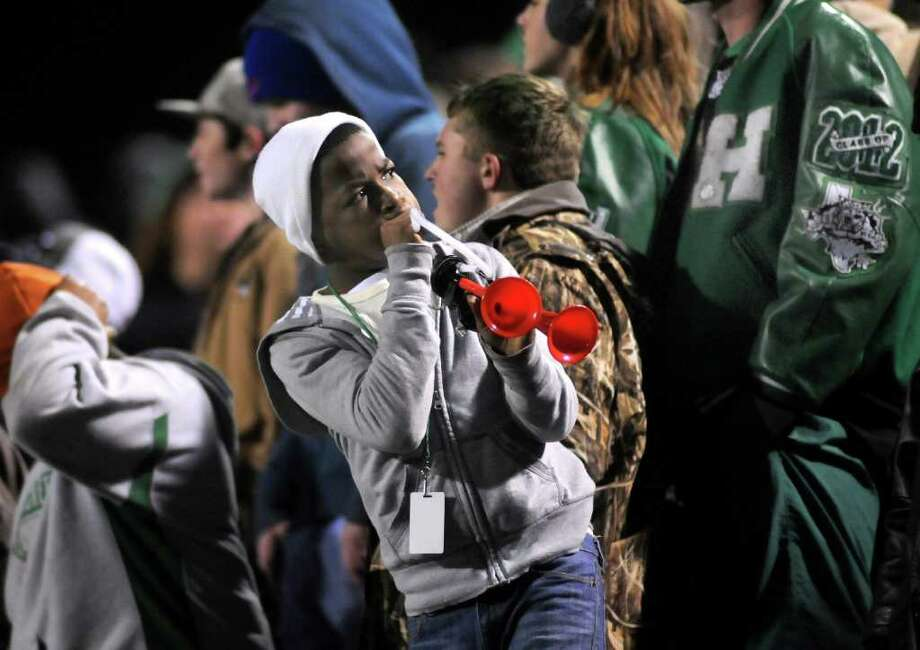 Hempstead fan De'Eric Lattimore, 13, a seventh grader at Hempstead Middle School, shows his support for the Bobcats. Photo: Jerry Baker, For The Chronicle
