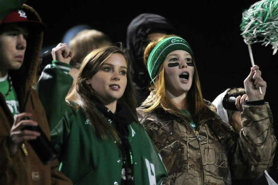 Hempstead fans Erin Harvey, 15, left, and Jada Williams, 15, both HHS sophomores, cheer on the Bobcats. Photo: Jerry Baker, For The Chronicle