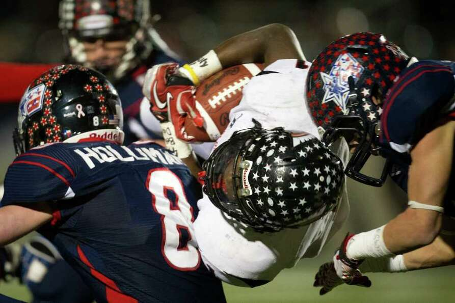 Coldspring running back Sherman Gilbert  is brought down by Wimberley defensive back Davis Holliman