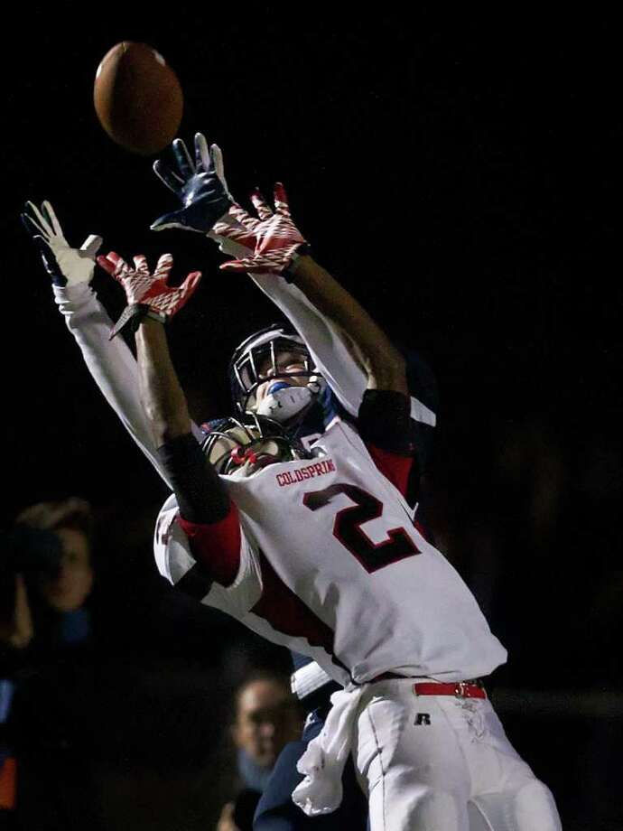 Wimberley wide receiver Brennen Blackemore, top, catches a touchdown pass over Coldspring defensive back Douglas Johnson (2) during the fourth quarter. Photo: Smiley N. Pool, Houston Chronicle / © 2011  Houston Chronicle