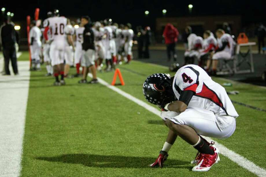 Coldspring's Jerrell Sykes (4) hangs his head on the bench during the fourth quarter of the Trojans' loss. Photo: Smiley N. Pool, Houston Chronicle / © 2011  Houston Chronicle
