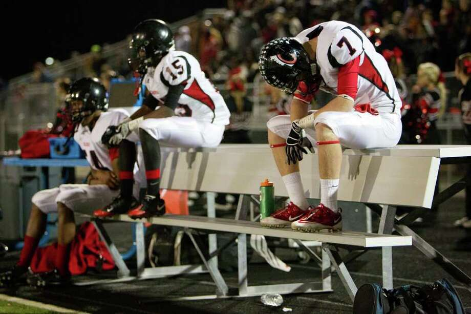 Coldspring's J.T. Wilson (7) hangs his head on the bench during the fourth quarter. Photo: Smiley N. Pool, Houston Chronicle / © 2011  Houston Chronicle