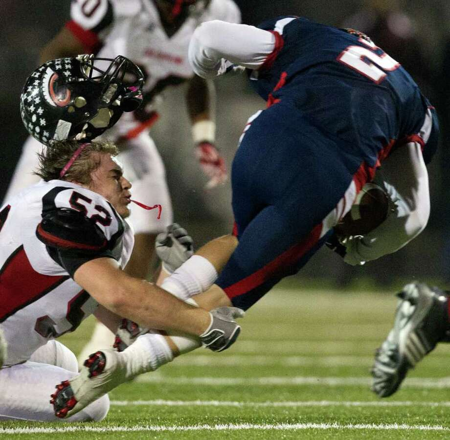 Coldspring defensive lineman Chance Andries (52) loses his helmet as he makes a stop on Wimberley wide receiver Brennen Blackemore (2) during the fourth quarter. Photo: Smiley N. Pool, Houston Chronicle / © 2011  Houston Chronicle