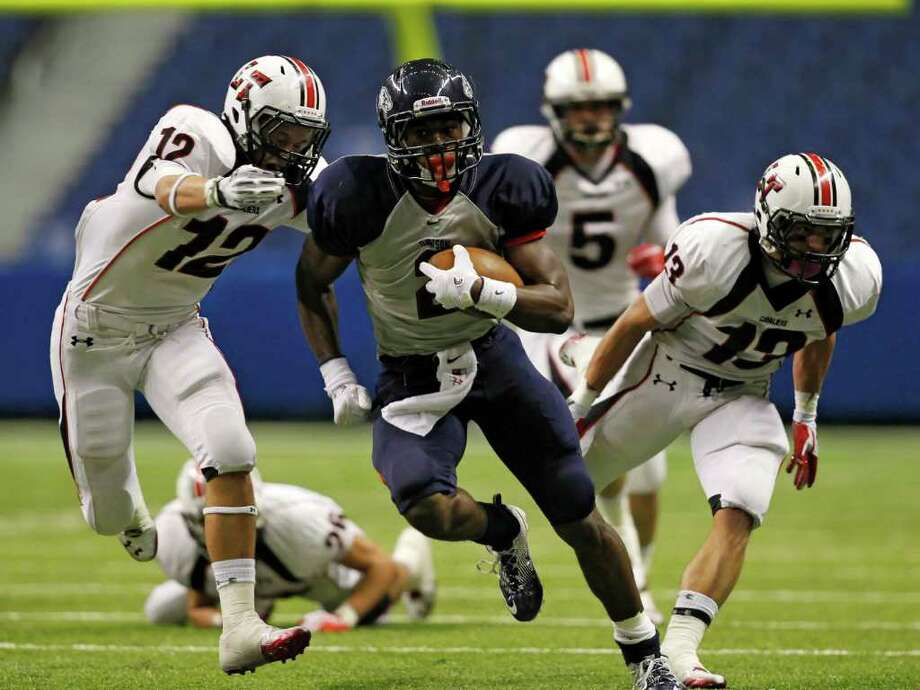 Dawson's James White (2) gets away from Lake Travis defenders on this run. Photo: Erich Schlegel, Houston Chronicle / ©2011 Erich Schlegel
