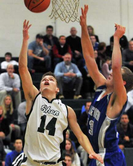 Shen's #14 Ted McCarthy,left, and Saratoga's #23 Erik Tallman during Friday night's game at Shenende