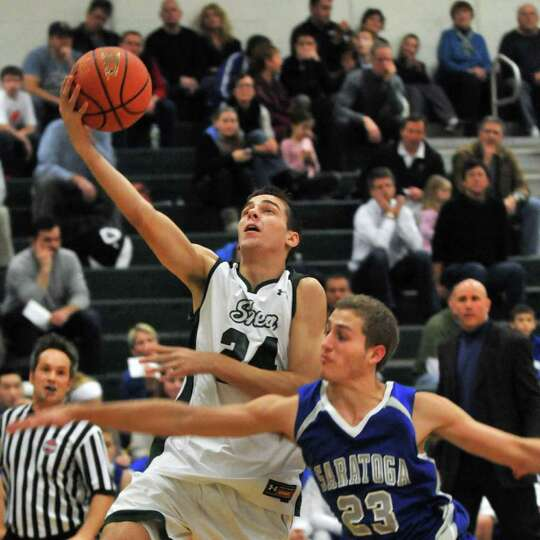 Shen's #24 Jake Hicks,left, goes to the basket against Saratoga's #23 Erik Tallman during Friday nig