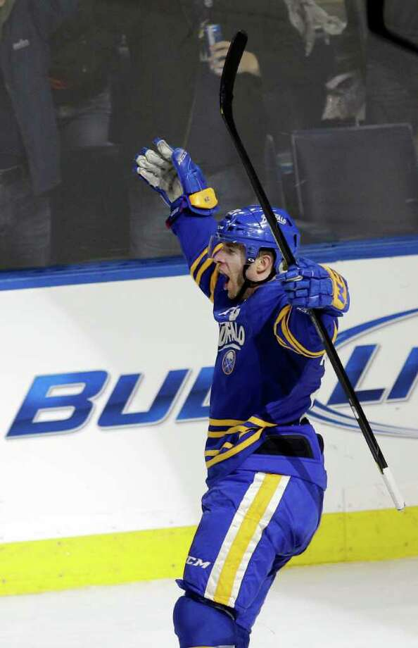 Buffalo Sabres' Jason Pominville celebrates after scoring the game-winning goal against the Florida Panthers during overtime of an NHL hockey game in Buffalo, N.Y., Friday, Dec. 9, 2011. The Sabres won 2-1. (AP Photo/David Duprey) Photo: David Duprey
