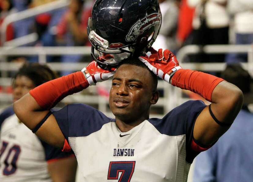Dawson's Mike Williams (7) sheds tears after losing 45-14 to Lake Travis.