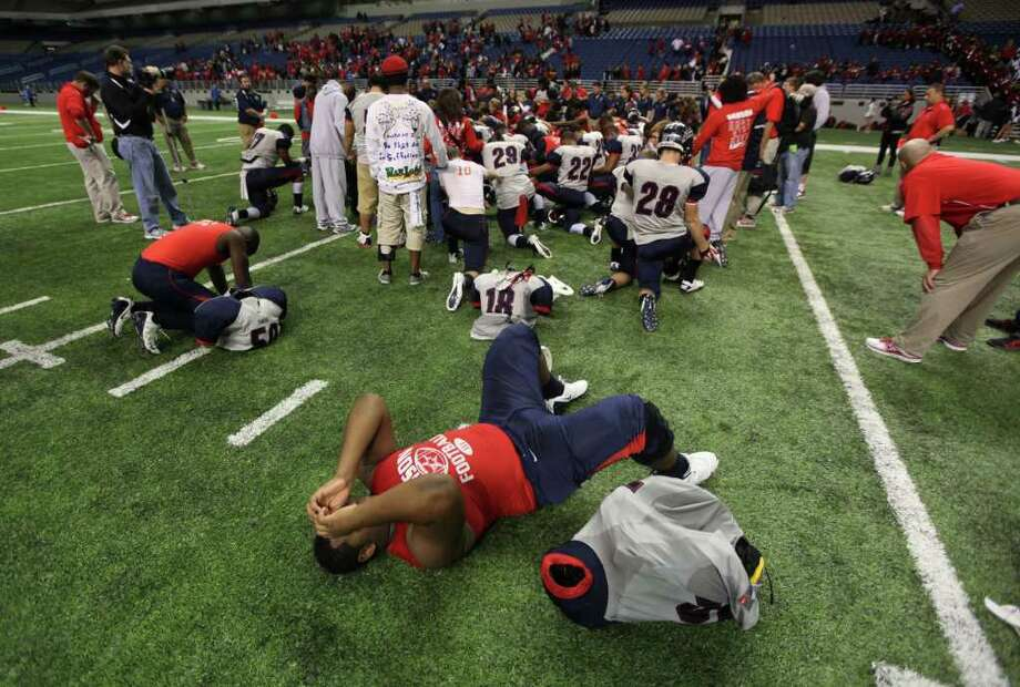 Dawson's Jasper Riley lies back after the Eagles lost to Lake Travis 45-14. Photo: Erich Schlegel, Houston Chronicle / ©2011 Erich Schlegel
