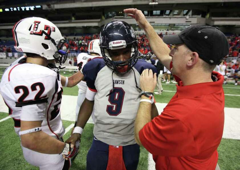 Dawson quarterback Garry Kimble shakes hands with Lake Travis defensive back Hunter Streuling (22) a