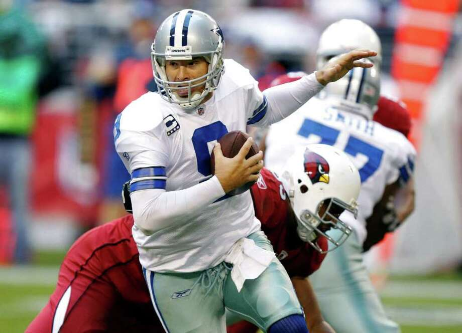 Cowboys quarterback Tony Romo, who was sacked a season-high five times last week against the Cardinals, won't get a break against the Giants, who are fifth in sacks with 33. Photo: AP