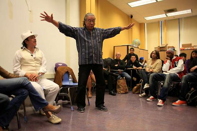 Edward James Olmos (center) talks to students as Carlos Santana (right) watches at Mission High school in San Francisco, Calif. on Monday, October 24, 2011. Photo: Lea Suzuki, The Chronicle