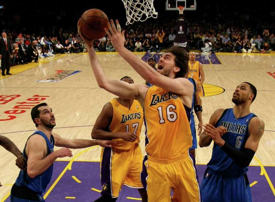 LOS ANGELES, CA - FILE:  Pau Gasol #16 of the Los Angeles Lakers goes up for a shot between Peja Stojakovic #16 and Tyson Chandler #6 of the Dallas Mavericks in Game Two of the Western Conference Semifinals in the 2011 NBA Playoffs at Staples Center on May 4, 2011 in Los Angeles, California. According to reports on December 8, 2011, Pau Gasol will be traded to the Houston Rockets.  NOTE TO USER: User expressly acknowledges and agrees that, by downloading and or using this photograph, User is consenting to the terms and conditions of the Getty Images License Agreement. Photo: Stephen Dunn, Getty / 2011 Getty Images