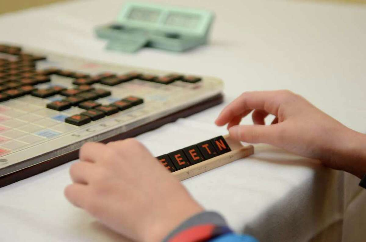 A competitor arranges her tiles during the three-day Northeast SCRABBLE (r) Championship at the Sheraton Hotel in downtown Stamford, CT on Sat., Dec. 10, 2011.