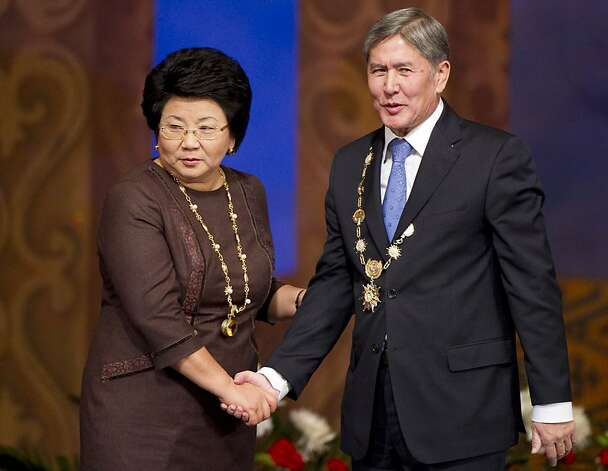 New Kyrgyz president Almazbek Atambayev, right, and his predecessor Roza Otunbayeva shake hands after an inauguration ceremony in Bishkek, Kyrgyzstan, Thursday, Dec. 01, 2011. Kyrgyzstan inaugurated a new president Thursday in the first peaceful transition of power in the former Soviet Central Asian nation. Speaking after his swearing-in, Almazbek Atambayev sounded a note of ethnic harmony and called on all political camps to unite to assure Kyrgyzstan's future prosperity. (AP Photo/ Vladimir Voronin)  Ran on: 12-11-2011 Outgoing President Roza Otunbayeva denounced Kyrgyzstan's practice of taking brides by force, but successor Almazbek Atambayev remains mum. Though outgoing President Roza Otunbayeva denounced Kyrgyzstan's practice of &quo;bride kidnapping,&quo; her successor, Almazbek Atambayev, said nothing. Photo: Vladimir Voronin, AP