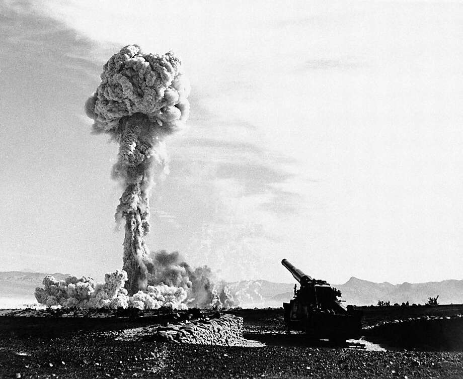 The towering lacy mushroom from the atomic cannon's first test rises from desert floor at Frenchman's flat, near Las Vegas, Nevada on May 25, 1953. The 280-mm gun which tossed the shell to its destination six or seven mile away is in the foreground. The rifle was touched off electrically, with the gun-loading crew entrenched a safe distance away. This picture, released on May 27, by the air force, was made probably about 10 seconds after the explosion. (AP Photo)  Ran on: 12-11-2011 Frenchman's flat near Las Vegas erupts in an atomic explosion from a canon-launched bomb on May 25, 1953, part of the United States' Cold War nuclear weapons tests. Is it time to rethink the role that nuclear arms will play in America's future?  Story, Page E6 Photo: AP