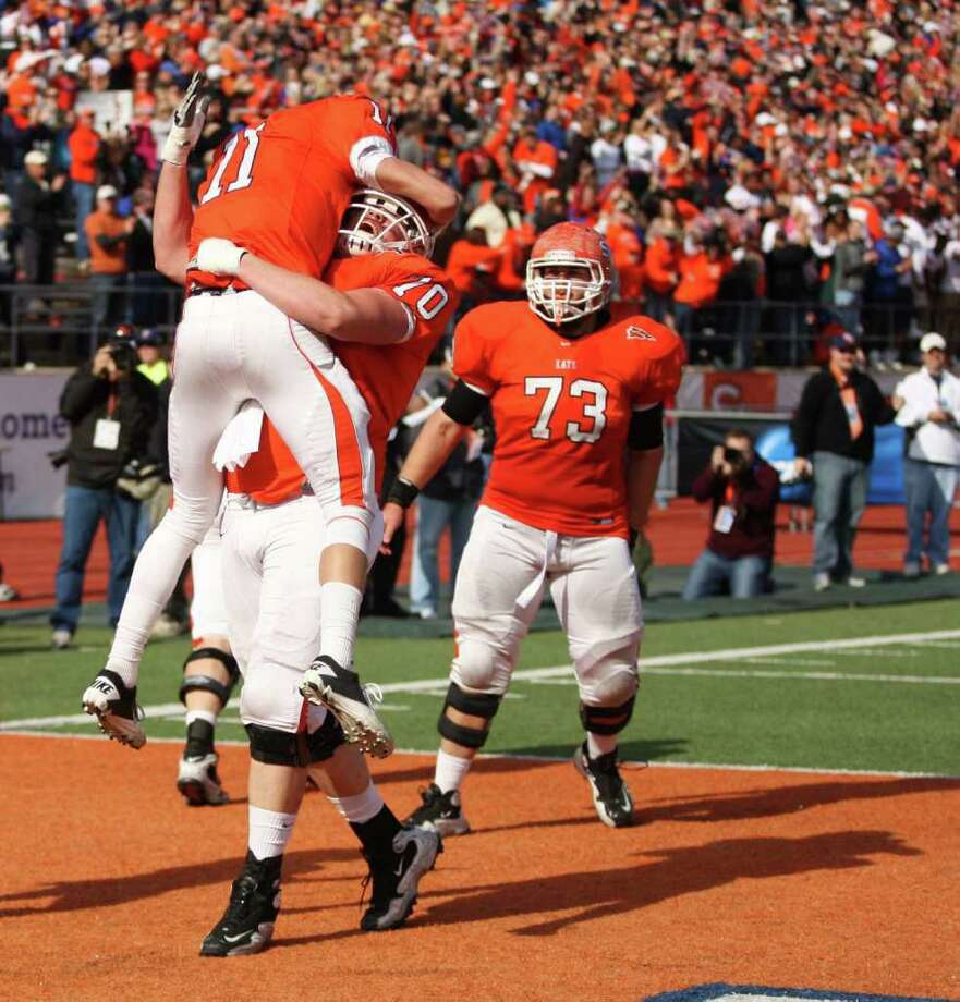 Sam Houston's Brian Bell (11) celebrates his touchdown with Dan Jenkins during the first half of a NCAA Division I football playoff quarterfinal against Montana State, Saturday, December 10, 2011 at Bowers Stadium in Huntsville, TX. Photo: Eric Christian Smith, For The Chronicle